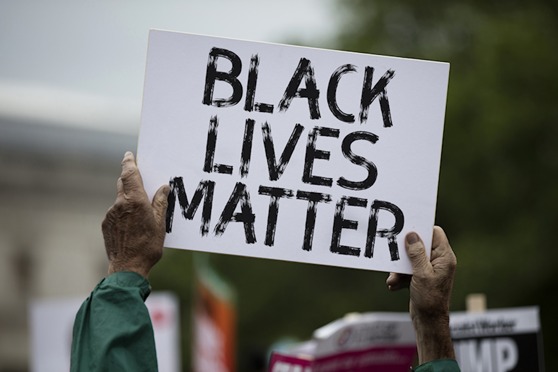 Man holding BLM sign
