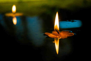 Candle floating on water